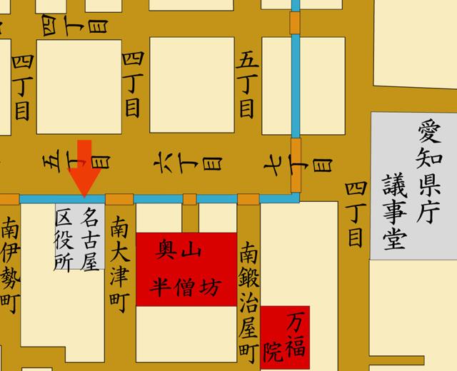 矢印の方向から市政発足時の名古屋市役所を撮影